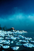USCG Station Marquette lighthouse in Michigan's Upper Peninsula during winter.