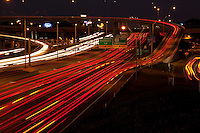 Car light trails on Highway 183 & Interstate 35 (I-35) freeway at night, long exposure, motion blur, elevated view