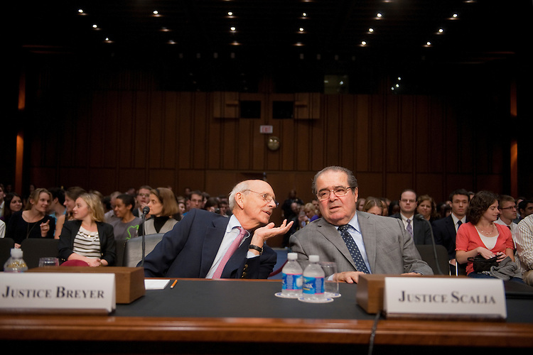 """UNITED STATES - OCTOBER 05:  Supreme Court Justices Stephen Breyer, left, and Antonin Scalia confer before testifying at a Senate Judiciary Committee hearing in Hart Building entitled """"Considering the Role of Judges Under the Constitution of the United States.""""  (Photo By Tom Williams/Roll Call)"""