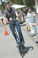 Santa Monica City Librarian Gregg Mullen test drives a stepper bike during Santa Monica Public Library's bicycles and cycling iCycle festival on Saturday, May 22, 2010