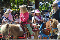 Children ride the ponies at the Santa Monica Farmers Market on Sunday, April, 1, 2012.