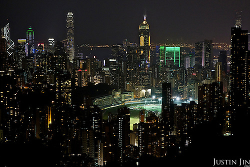 A panorama of Hong Kong, with the Hong Kong Jockey Club Happy Valley Racecourse in the middle.