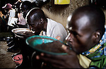 MYAGA, RWANDA - FEBRUARY 19: Prisoners accused of Genocide eat breakfast in their cells in a solidarity camp February 19, 2003 in a rural area close to Myaga, Rwanda. 800,000 mainly Tutsis and moderate Hutus were killed in about one hundred days in Rwanda in 1994. About 100,000 prisoners accused of the genocide are still in prisons nine years later awaiting trials. Rwanda is currently trying to cope with these problems of crime, punishment and reconciliation through village trials called Gacacas. Gacaca, which means on the grass, is a traditional way of solving disputes between local communities and involve juries of residents. 11,000 gacacas are currently trying to resolve crimes from the genocide. (Photo by Per-Anders Pettersson)