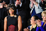First Lady Michelle Obama is welcomed to the House Chamber as they prepare to hear President Barack Obama deliver his first State of the Union since winning re-election at the U.S. Capitol in Washington, DC, USA on 12 February, 2013.
