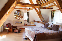 The massive oak beams in the master bedroom are a dominate feature