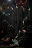 Women in a mosque during the religious celebration of Tasooa (Tasua), on the 9th day of Muharram.