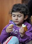 Gabriela Iseni, 4, a Roma girl whose family was displaced by a severe cold spell, eats a meal in a temporary shelter established by the Red Cross in Smederevo, Serbia. Church World Service has provided her family and others with food and other emergency supplies.