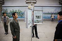 People read newspapers displayed inside a subway station visited by foreign reporters during a government organised tour in Pyongyang, North Korea October 9, 2015. One of the world's most inaccessible places, North Korea has invited foreign journalists to Pyongyang this week for celebrations marking the 70th anniversary of its ruling Workers' Party scheduled for October 10. REUTERS/Damir Sagolj