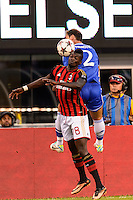 Mbaye Niang (78) of A. C. Milan  goes up for a header with Chelsea F. C. defender Branislav Ivanovic (2).  Chelsea F. C. defeated A. C. Milan 2-0 during round two of the 2013 Guinness International Champions Cup at MetLife Stadium in East Rutherford, NJ, on August 04, 2013.