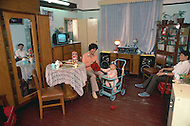 October 1984. In Shanghai, Mr. Lee, 33 years old, engineer ($28 a month) and his wife, Lee, 30 years old, accounting ($30 a month) and their baby Wu, 9 months old. They got married in 1980, (4 years ago), they have already a TV, a washing machine, 2 radio sets, built by Mr. Lee. They want to buy a refrigerator in one year.