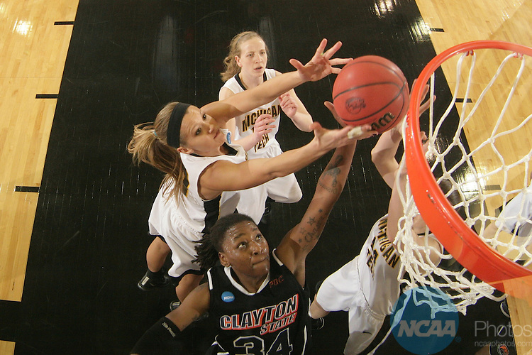25 MAR 2011: Forward Teshymia Tillman (34) of Clayton State fights for a rebound with Michigan Tech's (from left) Lindsey Lindstrom (20), Lucy Dernovsek (12), and Lisa Staehlin (14) during the Division II Women's Basketball Championship held at the St. Joseph Civic Center in St. Joseph, MO. Clayton State defeated Michigan Tech 69-50 to win the national title game.  Matthew Hicks/NCAA Photos.