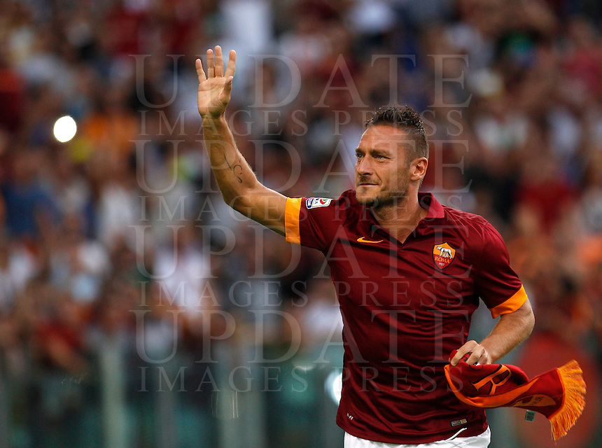 Calcio, amichevole Roma vs Fenerbahce. Roma, stadio Olimpico, 19 agosto 2014.<br /> AS Roma captain Francesco Totti greets fans during the team's presentation, prior to the friendly match between AS Roma and Fenerbache at Rome's Olympic stadium, 19 August 2014.<br /> UPDATE IMAGES PRESS/Riccardo De Luca