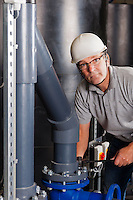 happy engineer with safety helmet, earplug and glasses