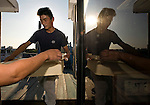 """Staff load food, drinks and ice for an evening aboard a """"Yakata-bune"""" pleasure boat run by Harumiya Co. in Tokyo, Japan on 31 August  2010. .Photographer: Robert Gilhooly"""