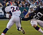 Oakland Raiders linebacker Eric Barton (50) attempts to tackle Denver Broncos running back Clinton Portis (26) on Sunday, December 22, 2002, in Oakland, California. The Raiders defeated the Broncos 28-16.