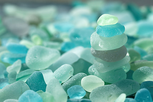 Weathered kelly green and light blue sea glass found at North Beach, Port Townsend, Jefferson County, Washington State, USA