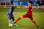 Chelsea FC player Gael Kakuta (L) fights for the ball with Paris Saint-German FC player Pastore Javier during their soccer match at the Yankee Stadium in New York, July 22, 2012. Photo by Eduardo Munoz Alvarez / VIEW.