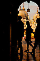 Tourists` silhouettes in front of the domes of St Mark's Basilica in Saint Marks`s Square (Plaze de San Marco) in Venice, Italy. June 9th 2008