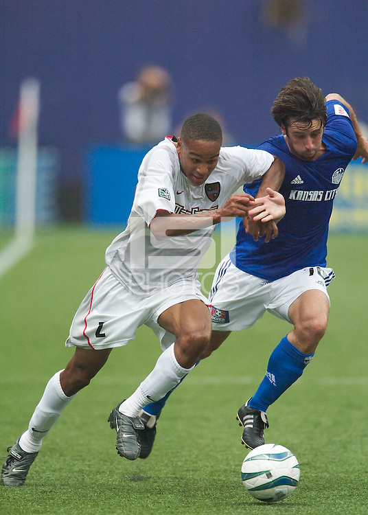 Ricardo Clark of the MetroStars and Stephen Armstrong of the Wizards battle for the ball. The Kansas City Wizards and the NY/NJ MetroStars played to a 0-0 tie on 8/13/03 at Giant's Stadium, NJ..