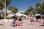 Couple walking through the grounds at Pueblo Bonito Rose' Resort, Cabo San Lucas, Baja California, Mexico