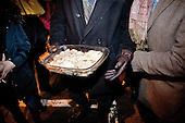 WARSAW, POLAND, December 24, 2016<br /> People sharing home-made dumplings on Christmas. Anti-government demonstrators are spending Christmas eve on the street by the Sejm, Polish parliament, occupied by the opposition MP's since December 17.<br /> The opposition objects to government plans to ban most of journalists from  covering parliamentary proceedings. The opposition MP's protest delayed a budget 2017 vote, which was later held away from the main parliament chamber and is now considered unlawful, which sparks further protest. The standoff has started December 17 and is bound to continue until the next parliamentary session scheduled for January 11.<br /> (Photo by Piotr Malecki / Napo Images)<br /> ****<br /> WARSZAWA, 24.12.2016. <br /> Wigilia przed sejmem. Ludzie przynosza z domu jedzenie. Poslowie opozycji z partii PO i Nowoczesna pozostaja w sali planarnej Sejmu,  nie opuszczajac jej od 17/12 i planuja pozostanie do nastepnego posiedzenia 11 stycznia. Jest to dzialanie w obronie wolnosci mediow i przeciwko uchwaleniu budzetu przez partie rzadzaca w innej sali, bez obecnosci poslow opozycji. <br /> Fot. Piotr Malecki / Napo Images<br /> <br /> ###ZDJECIE MOZE BYC UZYTE W KONTEKSCIE NIEOBRAZAJACYM OSOB PRZEDSTAWIONYCH NA FOTOGRAFII### ###