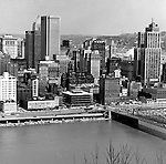 Pittsburgh PA:  View Pittsburgh, Fort Pitt Boulevard, William Penn Place, Grant Building and Smithfield Street Bridge - 1962.  1 Smithfield Street is under construction.