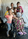 Delina Nleya and her children in Bulawayo, Zimbabwe. Nleya suffered a spinal cord injury and uses a wheelchair provided by the Jairos Jiri Association with support from CBM-US.