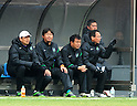 (R-L)  Takeshi Okada,  Takeshi Ono,  Suzuki,  Gao Sheng (Greentown),.FEBRUARY 25, 2012 - Football / Soccer :.Hangzhou Greentown FC head coach Takeshi Okada sits on the bench during a pre-season match between Omiya Ardija and Hangzhou Greentown FC at NACK5 Stadium Omiya in Saitama, Japan. Okada is a former Japan national team coach.