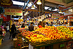 People crowd in for lunch at the Granville Island Market in downtown Vancouver, British Columbia which features fresh fruits and vegetables, a variety of take-away restaurants, bakeries and other food-oriented stalls in a large, open-air, covered market.