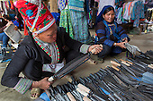 Hmong woman shopping at Muong Hum market, Vietnam.