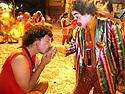 Tribute to revelry - reveler kissing clown´s hand at Rio de Janeiro street Carnival, Brazil.