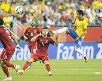 Brazil forward Neymar (10) leaps to intercept a high ball in front of Portugal midfielder Miguel Veloso (4).  In an International friendly match Brazil defeated Portugal, 3-1, at Gillette Stadium on Sep 10, 2013.