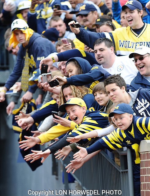 Pictures of the year 2012: Young fans wait to greet the players during Michigan's annual Spring Football Game at Michigan Stadium, Saturday, April 15th.