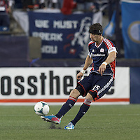 New England Revolution defender Stephen McCarthy (15) clears the ball. In a Major League Soccer (MLS) match, the New England Revolution (blue) tied New York Red Bulls (white), 1-1, at Gillette Stadium on May 11, 2013.