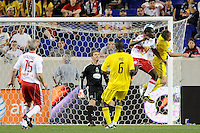 Tony Tchani (23) of the New York Red Bulls out jumps Brian Carroll (16) of the Columbus Crew and heads the ball for a goal as Columbus Crew goalkeeper William Hesmer (1) looks on. The Columbus Crew defeated the New York Red Bulls 3-1 during a Major League Soccer (MLS) match at Red Bull Arena in Harrison, NJ, on May 20, 2010.