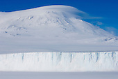 The Barne Glacier with Mount Erebus in the background seen from ice level on McMurdo Sound, Antarctica.