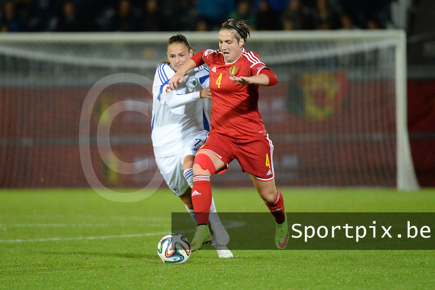 20150922 - LEUVEN ,  BELGIUM : Belgian Maud Coutereels (4) and Bosnia and Herzegovina's Eldina Ahmic (7)  pictured during the female soccer game between the Belgian Red Flames and Bosnia and Herzegovina , the first game in the qualification for the European Championship in France 2017  , Thursday 22 September 2015 at Stadion Den Dreef  in Leuven , Belgium. PHOTO DAVID CATRY