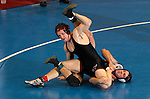 12 MAR 2011:  Ryan Pankoke of Nebraska-Omaha (in black with red trim) wrestles Luke Rynish of Wisconsin-Parkside during the Division II Men's Wrestling Championship held at the UNK Health and Sports Center on the University of Nebraska - Kearney campus in Kearney, NE.  Pankoke defeated Rynish to win the 174-lb national title.  Corbey R. Dorsey/ NCAA Photos