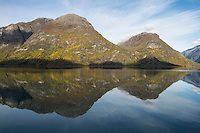 Autumn mountain reflection on lake Oppstrynsvatnet, Sogn of Fjordane, Norway