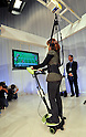 November 1, 2011, Tokyo, Japan - A model demonstrates a mobility aid which works like a skateboard to help people relearn balance as the automaker unveiled experimental robots for nursing and healthcare aimed for commercialization from 2013 to the media at its facility in Tokyo on Tuesday, November 1, 2011. (Photo by Natsuki Sakai/AFLO) [3615] -mis-