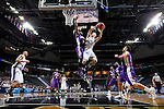 24 MAR 2012:  Zach Henifin (34) of Western Washington University drives to the hoop against Drico Hightower (32) of the University of Montevallo during the Division II Men's Basketball Championship held at the Bank of Kentucky Center in Highland Heights, KY.  Western Washington defeated Montevallo 72-65 for the national title.  Joe Robbins/NCAA Photos
