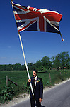 """Union flag is carried at the head of the [Grovely Forest Right] procession. [Wishford Magna], Wiltshire, England """"Oak Apple Day"""