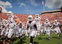 HAWGS ILLUSTRATED JASON IVESTER --08/30/2014--<br /> Arkansas players run onto the field on Saturday, Aug. 30, 2014, before their game against Auburn at Jordan-Hare Stadium in Auburn, Ala.