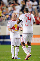 Luke Rodgers (9) of the New York Red Bulls celebrates scoring with Thierry Henry (14). The New York Red Bulls defeated Toronto FC 5-0 during a Major League Soccer (MLS) match at Red Bull Arena in Harrison, NJ, on July 06, 2011.