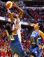 INDIANAPOLIS, IN - OCTOBER 21: Tamika Catchings #24 of the Indiana Fever shoots the ball as Monica Wright #22 of the Minnesota Lynx fouls during Game Four of the 2012 WNBA Finals on October 21, 2012 at Bankers Life Fieldhouse in Indianapolis, Indiana. NOTE TO USER: User expressly acknowledges and agrees that, by downloading and or using this Photograph, user is consenting to the terms and conditions of the Getty Images License Agreement. (Photo by Michael Hickey/Getty Images) *** Local Caption *** Tamika Catchings; Monica Wright