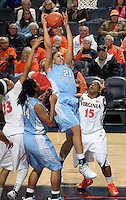 CHARLOTTESVILLE, VA- JANUARY 5: Krista Gross #21 of the North Carolina Tar Heels grabs a rebound over Ariana Moorer #15 of the Virginia Cavaliers during the game on January 5, 2012 at the John Paul Jones arena in Charlottesville, Virginia. North Carolina defeated Virginia 78-73. (Photo by Andrew Shurtleff/Getty Images) *** Local Caption *** Ariana Moorer;Krista Gross