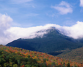 Autumn colors and snowcapped peaks of the Presidential Range, White Mountains National Forest, New Hampshire, USA.