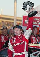 Bill Elliott raises his trophy in victory lane after winning the Pop Secret 400 NASCAR Winston Cup race at Rockingham, NC on Sunday, November 9, 2003. (Photo by Brian Cleary)