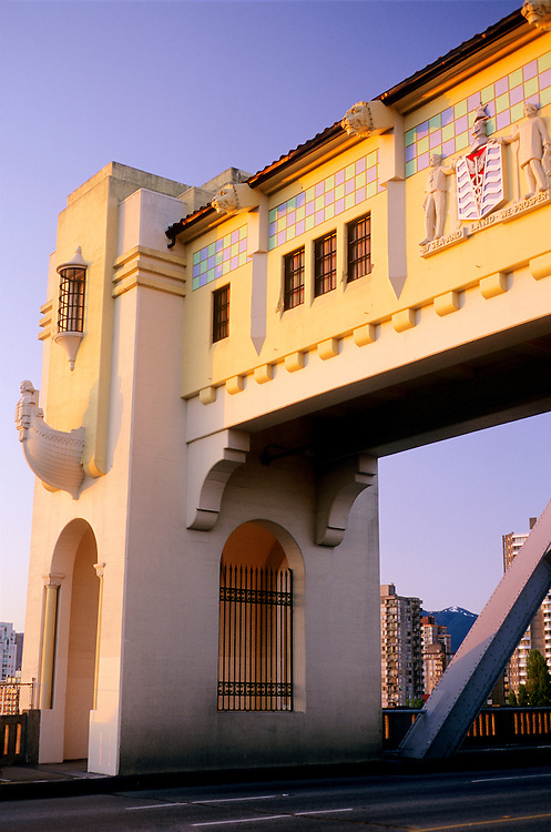 Art deco and Spanish colonial ornamentation and decoration, lamps, lions, boats, statues, and coat of arms on the Burrard Bridge at sunset, Vancouver, BC.