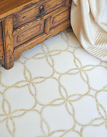 Waverly, a stone waterjet and hand cut mosaic shown in Crema Marfil and Thassos is part of the Silk Road Collection by Sara Baldwin for New Ravenna Mosaics.